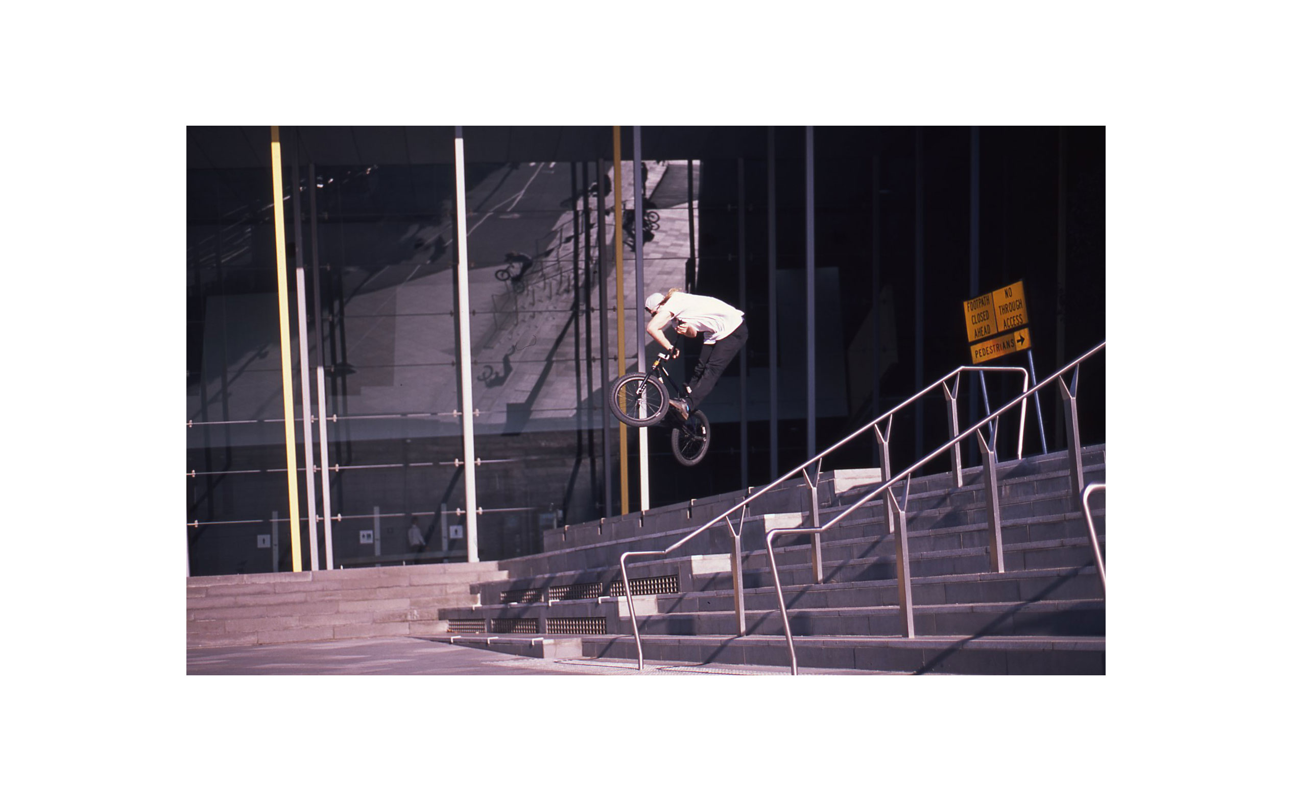 Bradley Anderson - Insanely twisted x-up doubled up by his reflection in the background.