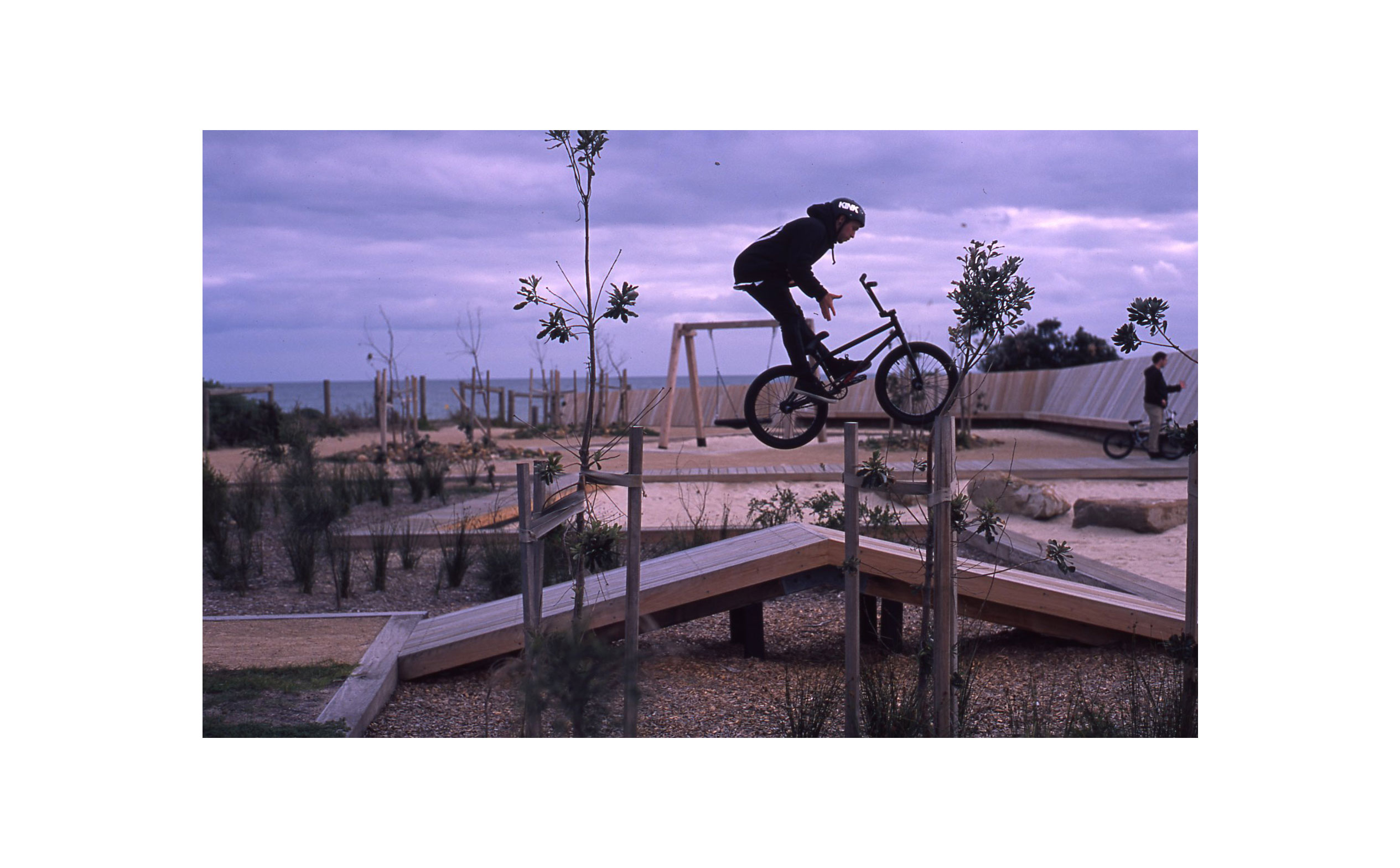 Alex Bolton - Perfectly timed barspin at a picture-perfect playground near the beach.